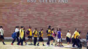 Students leave after the day's classes at Emma Hutchinson School, which has been identified as one of 44 schools involved in a test cheating scandal. Investigators have concluded that nearly half the city's schools allowed cheating to go unchecked for as long as a decade, beginning in 2001.