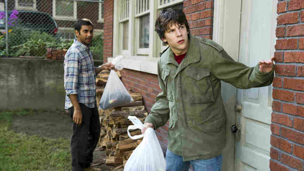 Totally Trashed: Nick (Jesse Eisenberg, right) enlists his best friend Chet (Aziz Ansari) to help  him rob a bank after two dim-witted criminals strap a bomb to his chest. Though  the pizza-delivery man who inspired the film died in real life, director Ruben  Fleischer opts for a  lighthearted (and sloppy) approach to the  story.