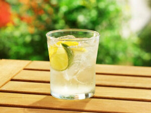 Glass of water in an outdoor patio setting.