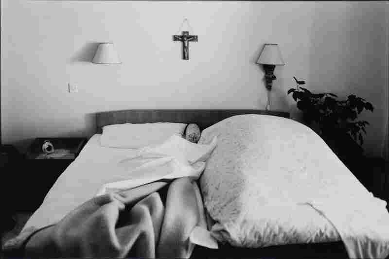 The Widow still makes the bed every day on her husband's side.