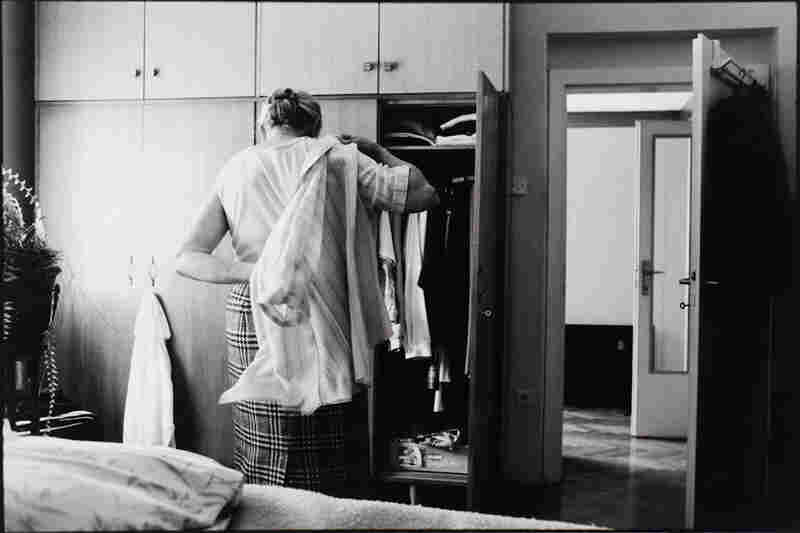 The Widow getting dressed in the morning, humbly and modestly.