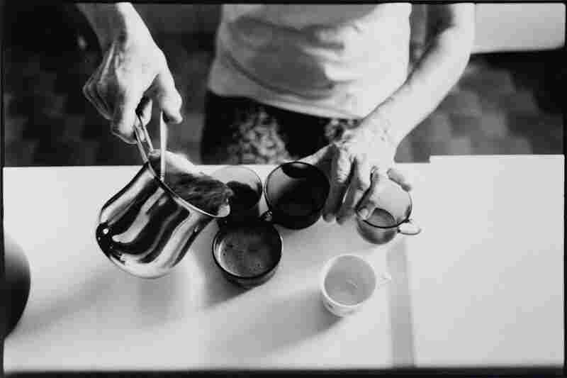 The Widow preparing coffee, an everyday ritual; through wonderfully scented coffee she shares her love with her offspring.