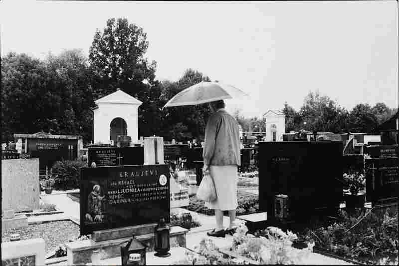 The Widow on her visit to her beloved husband's grave, bringing him flowers and a candle.