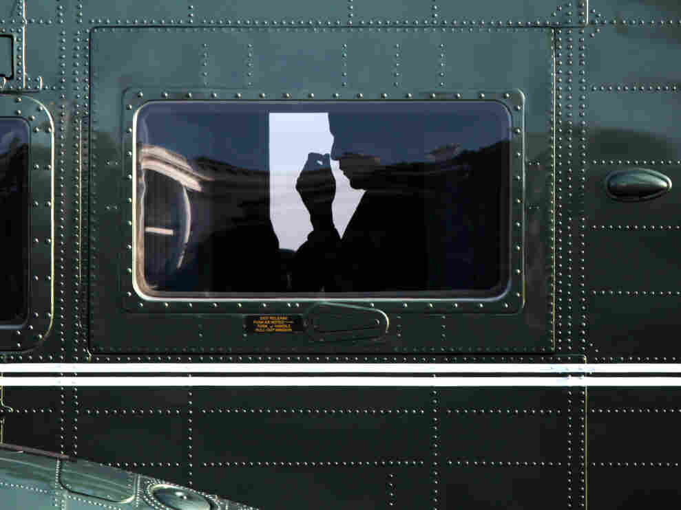 President Obama seen in silhouette inside Marine One helicopter on the White House South Lawn, Aug. 9, 2011.