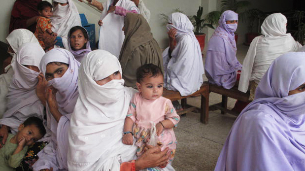 Women and children overflow the waiting room of Uma Mumtaz Hospital, a private philanthropic medical clinic in rural Pakistan.  Since opening three years ago, the medical center has served over 130,000 patients, with free basic medical care, medicine and family planning counseling.
