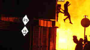 Woman's Leap To Safety Becomes An Iconic Image Of London Riots