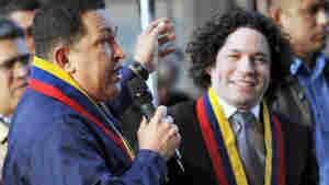 Venezuelan president Hugo Chavez and his compatriot Gustavo Dudamel, together in Caracas.