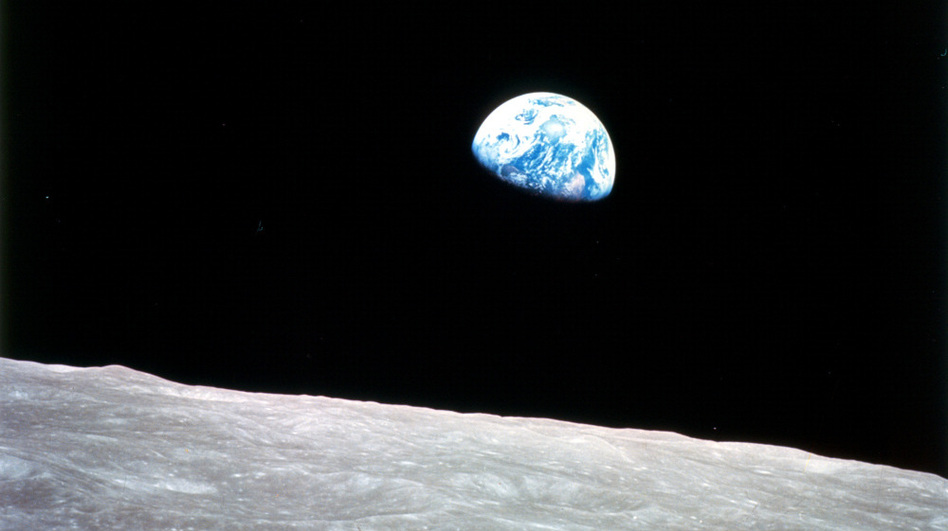 While orbiting the moon, Apollo 8 astronauts were greeted by this view of the rising earth. Today, competitors in the Google Lunar X PRIZE are trying to build robots that could reach the moon by the end of 2015. (NASA )