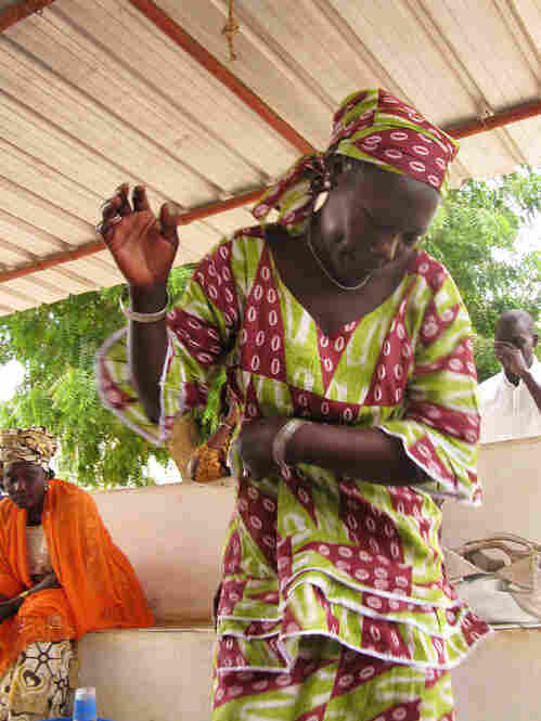 The women spontaneously break into song and dance during the discussion.