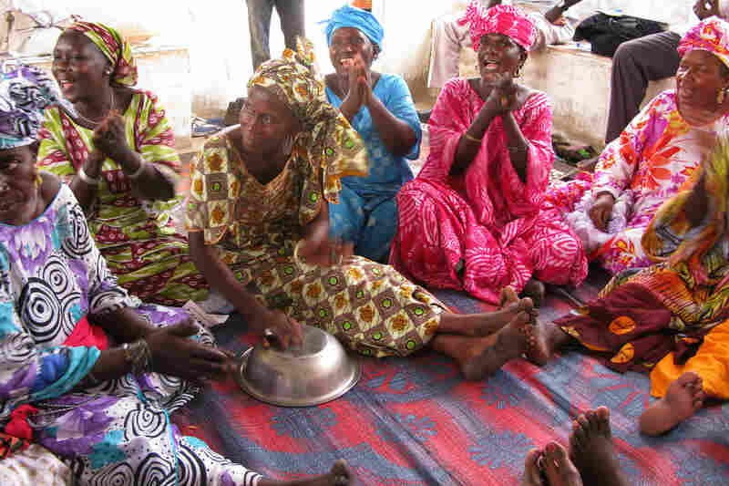 The women sing during a health care and advice session.