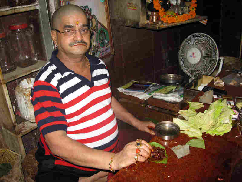 Paan seller Jitender Verma sits in his shop in old Delhi's Chandni Chowk market. He has been making and selling paan in this family business for 40 years, but now faces competition from a cheap form of chewing tobacco.