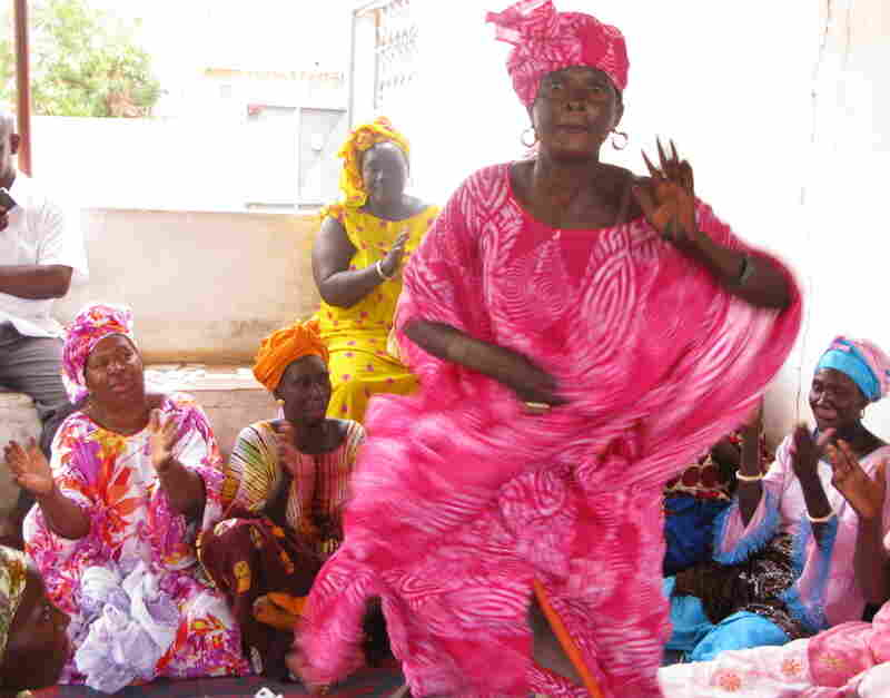 Lightening the mood, the otherwise serious health care proceedings are  punctuated by song and dance.