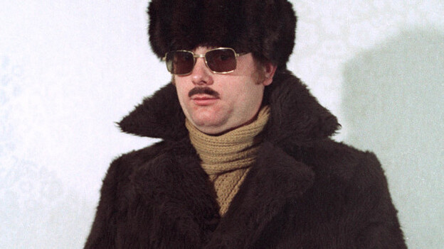 Staged photos re-create Stasi agents dressed in various disguises, ranging from a Russian mafioso to the casual middle-aged man to a tourist with cameras. (Simon Menner)