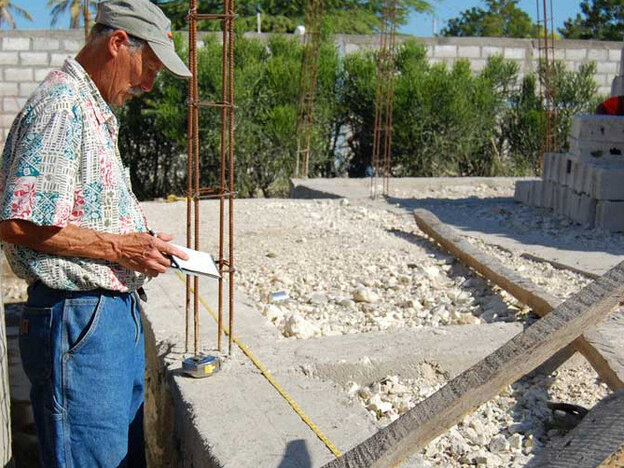 Tim Myers measuring the subpar foundation at the school site.