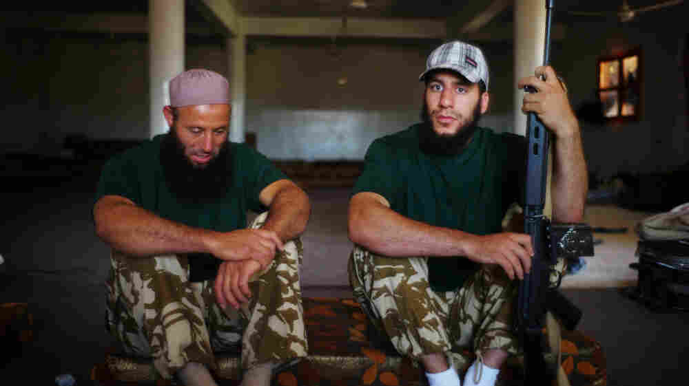 Mabruk Eshnuk (left) and his son Malik left their home in Pittsburgh to volunteer and fight with rebels in western Libya's Nafusa Mountains.