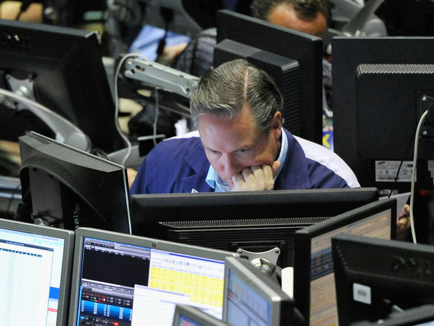A trader studies his computer screen in the VIX pit at the Chicago Board Options Exchange on April 27.