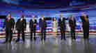 Republican presidential candidates participated in the Iowa GOP/Fox News Debate at the CY Stephens Auditorium in Ames, Iowa, Thursday. From left, former Sen. Rick Santorum (R-PA); businessman Herman Cain; Rep. Ron Paul (R-TX), former Massachusetts Gov. Mitt Romney; Rep. Michele Bachmann (R-MN); former Minnesota Gov. Tim Pawlenty; former Utah Gov. Jon Huntsman; former House Speaker Newt Gingrich.