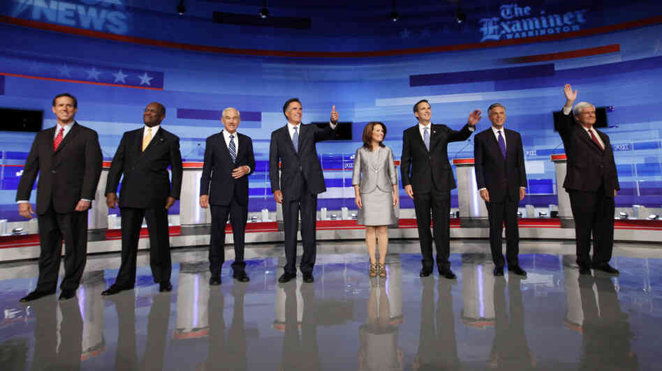 Republican presidential candidates participated in the Iowa GOP/Fox News Debate at the CY Stephens Auditorium in Ames, Iowa, Thursday. From left, former Sen. Rick Santorum (R-PA); businessman Herman Cain; Rep. Ron Paul (R-TX), former Massachusetts Gov. Mitt Romney; Rep. Michele Bachmann (R-MN); former Minnesota Gov. Tim Pawlenty; former Utah Gov. Jon Huntsman; former House Speaker Newt Gingrich.