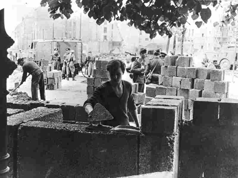 An East German worker lays some of the first stone blocks of the wall shortly after the border between East and West Berlin was sealed in August 1961.