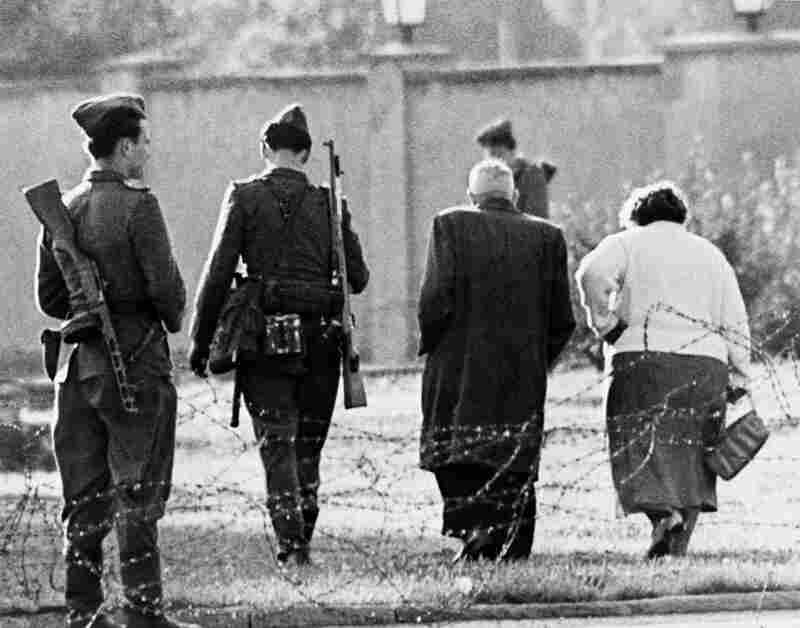 An East German couple is turned away from the border after trying to cross into West Berlin on Aug. 13, 1961. To stem the flow of refugees to the West, East Germany closed the border to all citizens and residents, except those with a special police permit.