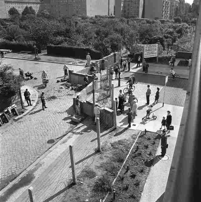 East German workers assemble a wall of concrete blocks in the French sector of East Berlin on Aug. 15, 1961.