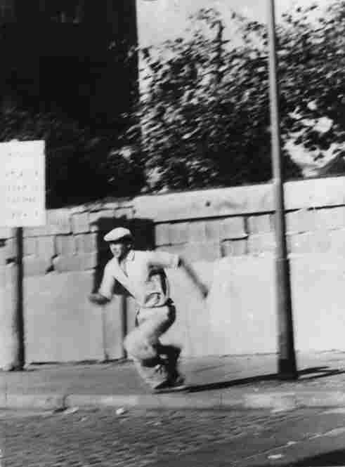 A man runs after climbing over the wall from East Berlin to West Berlin on Oct. 16, 1961.