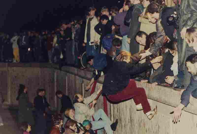 West Berliners help East Berliners over the wall on Nov. 10, 1989.