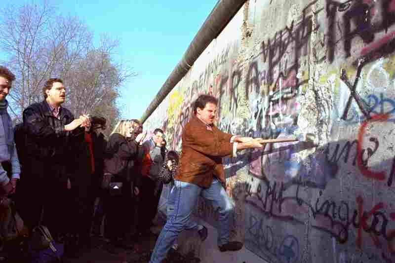 A West Berliner swings a sledgehammer into the wall on Nov. 12, 1989.