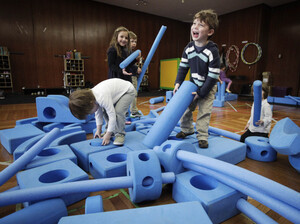 Children play with blue foam building blocks at the Blue School in New York City on March 31. The private preschool was founded by members of the Blue Man Group who wanted to send their own children to a school they felt supported creativity.