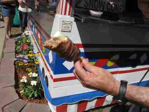 Don Gonyea holds deep-fried butter on a stick.