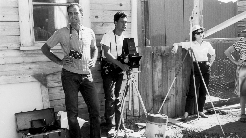 Magnum photographer Elliott Erwitt (center) and his colleagues during the filming of The Misfits on location in Nevada, 1960.
