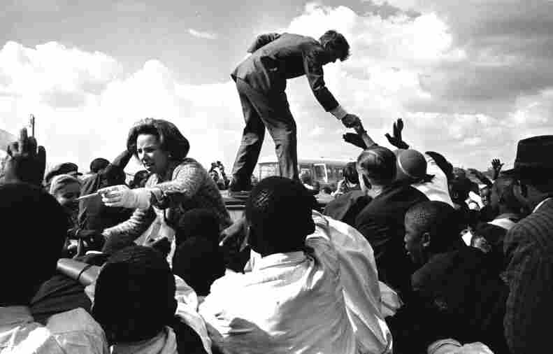 Robert F. Kennedy and his wife, Ethel, were enthusiastically received in the then-majority black township of Soweto, South Africa. They spent much of the time greeting locals from the roof of their car.