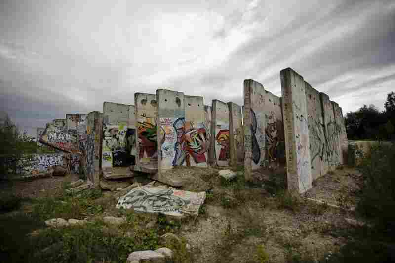 Original parts of the Berlin Wall stand at the site of a construction company in Teltow, Berlin, on Aug. 11, 2011. Saturday is the 50th anniversary of the construction of the wall, which divided the eastern and western parts of the city.