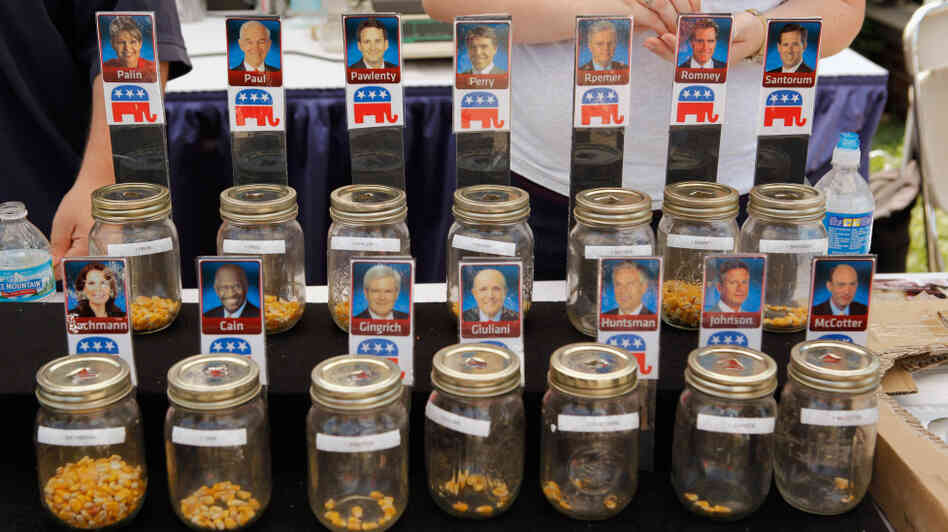 Voters put corn kernels into jars with their favorite Republican presidential candidates on the first day of the Iowa State Fair in Des Moines on Thursday.