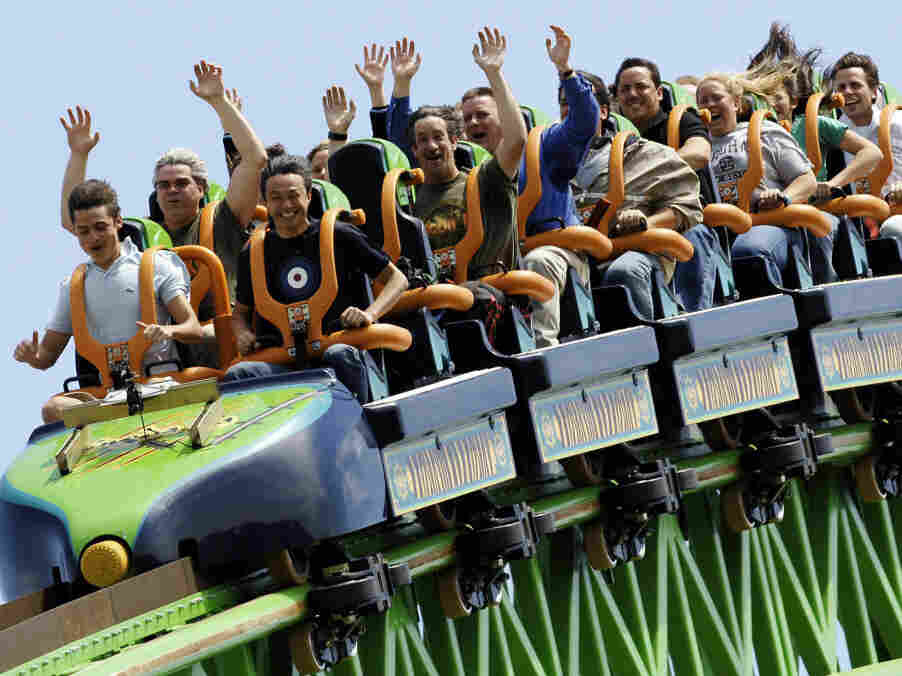 """Riders raise their arms as they travel the """"Kingda Ka"""" roller coaster at Six Flags amusement park in Jackson, New Je"""