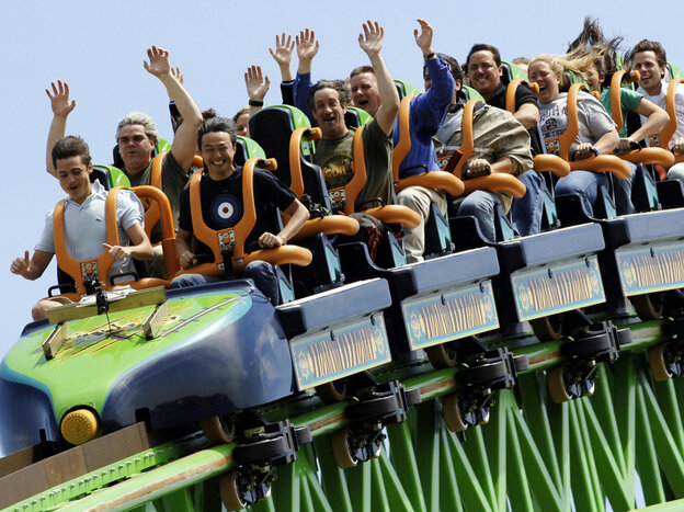 """Riders raise their arms as they travel the """"Kingda Ka"""" roller coaster at Six Flags amusement park in Jackson, New Jersey. This is one of the many parks Karol Gadja would have visited this summer if his tripped hadn't been cut short."""