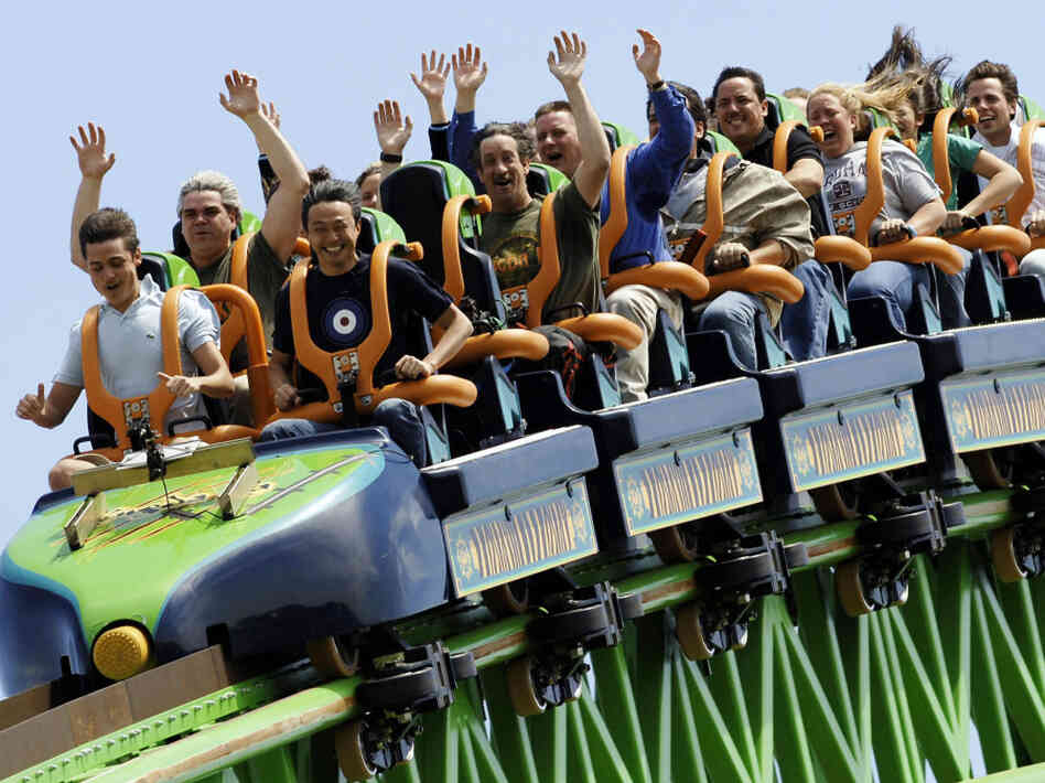 "Riders raise their arms as they travel the ""Kingda Ka"" roller coaster at Six Flags amusement park in Jackson, New Jersey. This is one of the many parks Karol Gadja would have visited this summer if his tripped hadn't been cut short."