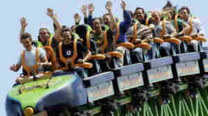 "JACKSON, UNITED STATES:  Riders raise their arms as they travel the ""Kingda Ka"" roller coaster 19 May, 2005, at Six Flags amusement park in Jackson, New Jersey. The roller coaster is billed as the tallest at 456 feet (139 meters) and fastest, 128 mph (205 kph) on the Earth.  AFP PHOTO/Stan HONDA  (Photo credit should read STAN HONDA/AFP/Getty Images)"