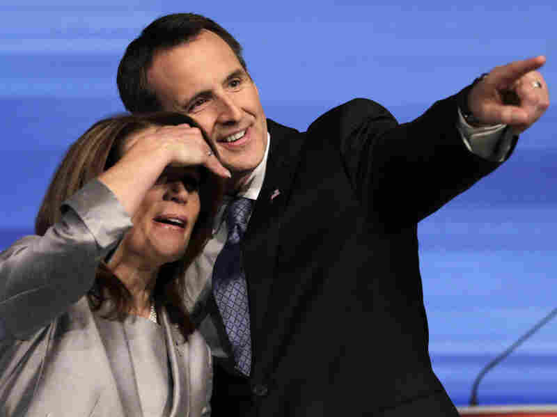 Republican presidential candidates Michele Bachmann and Tim Pawlenty look to the audience before the start of the Iowa GOP/Fox News Debate at the CY Stephens Auditorium in Ames, Iowa, Thursday, Aug. 11, 2011.