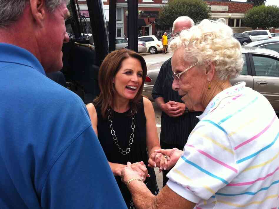 Rep. Michele Bachmann greets a voter in Pella, Iowa.