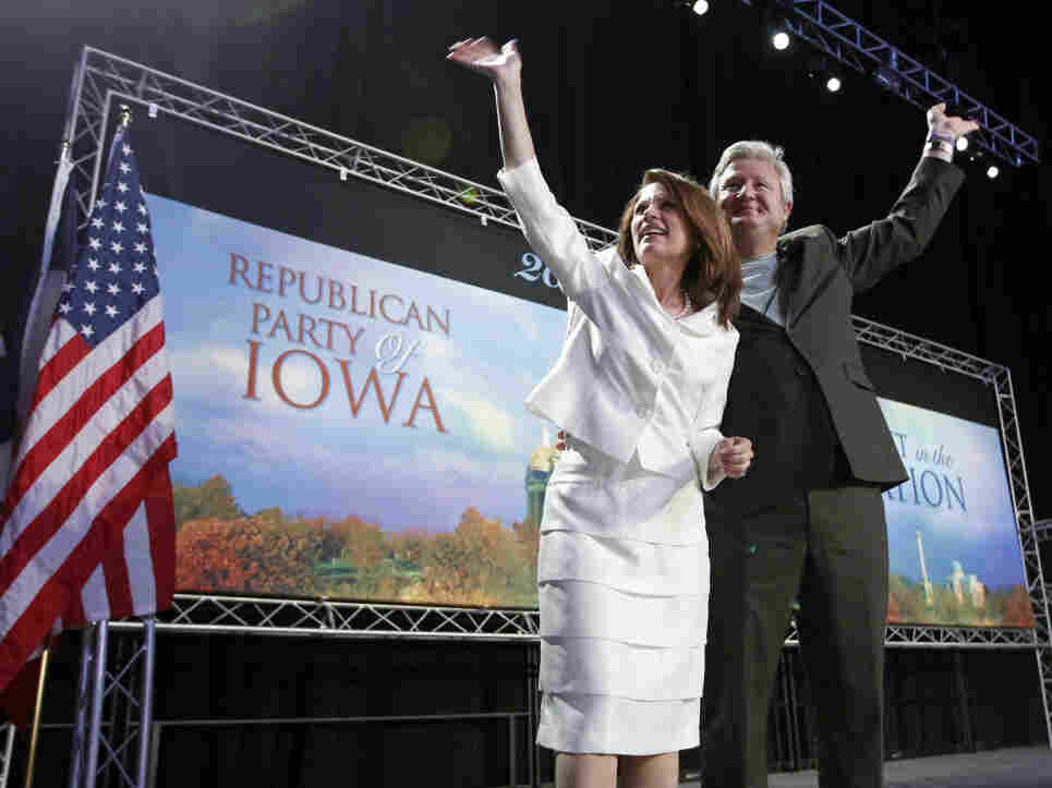 Republican presidential candidate Rep. Michele Bachmann (R-MN) and her husband, Marcus, wave to the crowd after she speaks at the Iowa Republican Party's straw poll in Ames, Iowa, on Saturday. Bachmann won the poll with 4,823 votes.