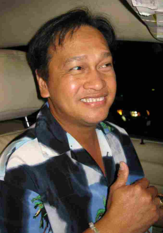 Karaoke cab driver Joel Laguidao has two requirements for his passengers' singing: loud and loud.