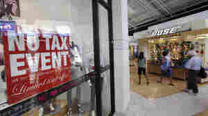 Shoppers stroll through Sawgrass Mills Mall during the first day of the back-to-school sales tax holiday on Friday in Sunrise, Fla. The Commerce Department said retail sales rose 0.5 percent in July.