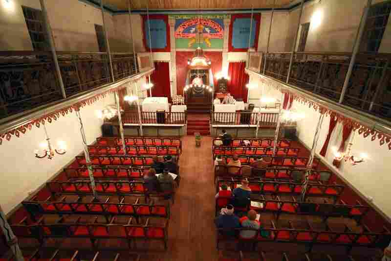 In Basavilbaso, Argentina, about 15 people attend a Friday night Shabbat celebration at the Tefila L'Moises Synagogue. Community leaders have managed to conserve the old synagogue, which has served the Jewish community for about a century, but very few people still attend services.