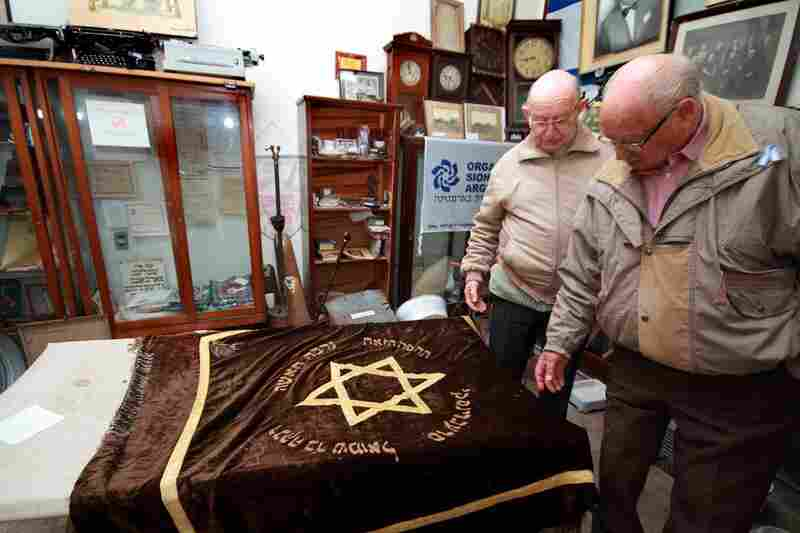 Enrique Salomon (right) and Jose Roimiser have collected old objects and documents from more than a century ago, when Jews from Russia, Ukraine and Poland were flowing into this region.