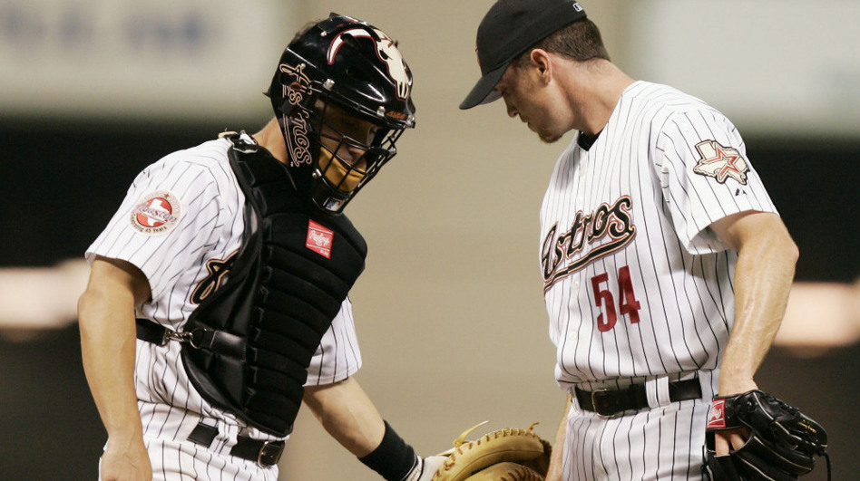 Ausmus (left), playing for the Houston Astros in 2006, talks with pitcher Brad Lidge on the mound during a game. (AP)