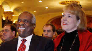 Supreme Court Justice Clarence Thomas and his wife, Virginia, listen as he is introduced prior to speaking at the Federalist Society in Washington on Nov. 15, 2007. The Thomases drew criticism for Virginia's role as co-founder, president and CEO of Liberty Central, a political group that advertises itself as linked to the Tea Party movement. She later stepped down.