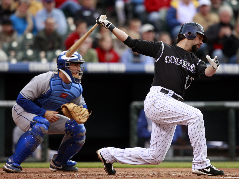 Catcher Brad Ausmus (left), with the L.A. Dodgers in May 2009, is at the ready as the Colorado Rockies' Todd Helton bats during a game in Denver.