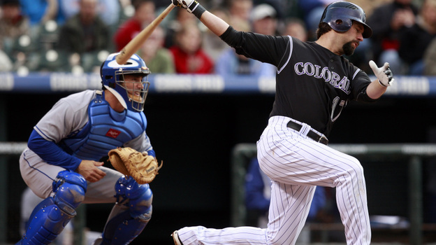 Catcher Brad Ausmus (left), with the L.A. Dodgers in May 2009, is at the ready as the Colorado Rockies' Todd Helton bats during a game in Denver. (AP)