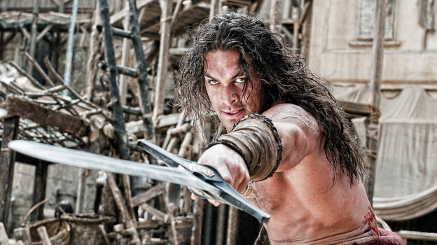 Conan O'Barbarian: Conan (Jason Momoa) is charged with using his wooden stoicism to prevent ancient warmongers from unleashing their supernatural hammy acting on an unsuspecting public. Though the film's lore tells us he was born on a battlefield, in truth this Conan was born out of Hollywood's current joint lust for remakes and sword-and-sandals mythos.